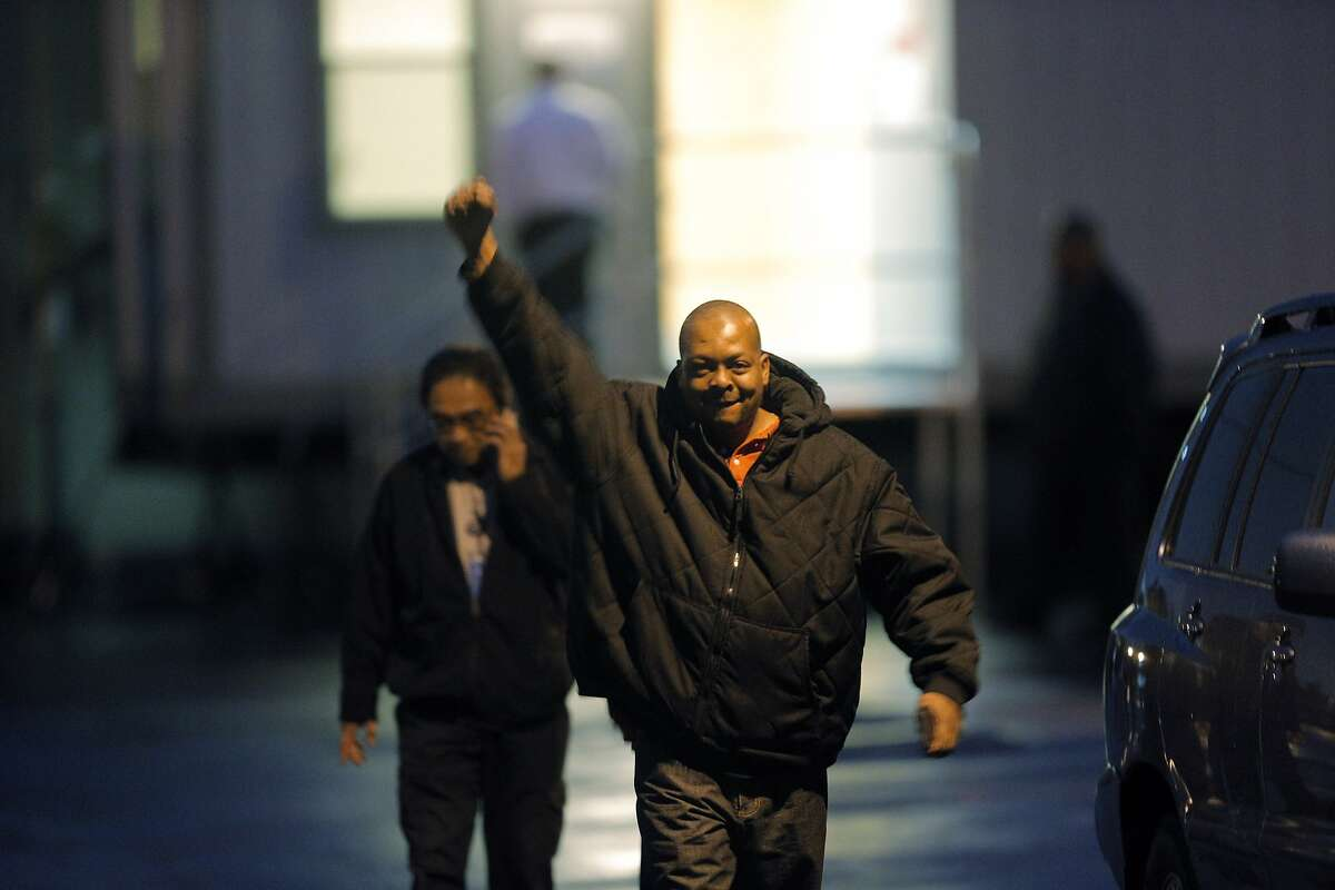 Demaurae Houston, a driver for Loop Transportation, raises his fist in triumph as their vote to unionize was affirmed on Wednesday. Employees of Loop Transportation voted on Wednesday, November 19, 2014, to unionize and join Teamsters Local 853 at the company's headquarters in San Carlos, Calif. The employees are the first tech bus drivers to unionize, seeking better working conditions.