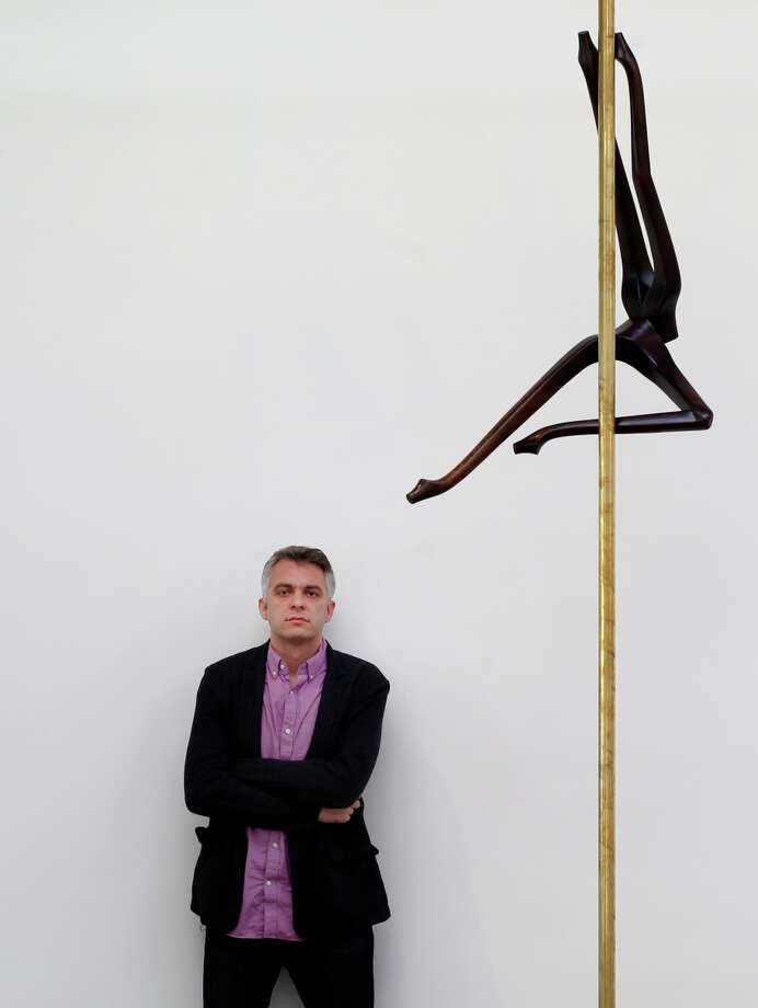 """Anthony Huberman stands near a sculpture by Markus Schninwald called """"Untitled Legs"""" (2013). Photo: Brant Ward / The Chronicle / ONLINE_YES"""
