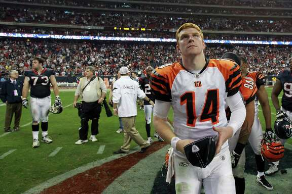 Bengals quarterback Andy Dalton contemplates the first two playoff losses he suffered at the hands of the Texans.