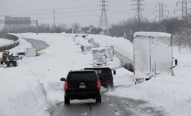 New  York Gov. Andrew Cuomo's motorcade drives on the Thruway past abandoned vehicles near Cheektowaga, N.Y., Wednesday, Nov. 19, 2014. State officials say the Thruway will stay closed in the Buffalo area for the duration of a lake-effect storm that has dumped 6 feet of snow since Tuesday and is expected to bring a couple more feet through Thursday.  (AP Photo/The Buffalo News, Sharon Cantillon)  TV OUT; MAGS OUT; MANDATORY CREDIT; BATAVIA DAILY NEWS OUT; DUNKIRK OBSERVER OUT; JAMESTOWN POST-JOURNAL OUT; LOCKPORT UNION-SUN JOURNAL OUT; NIAGARA GAZETTE OUT; OLEAN TIMES-HERALD OUT; SALAMANCA PRESS OUT; TONAWANDA NEWS OUT   ORG XMIT: NYBUE309 Photo: Sharon Cantillon / The Buffalo News