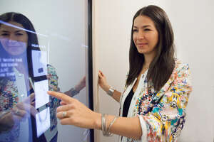 Designer Rebecca Minkoff uses a dressing room mirror that doubles as a touch screen.