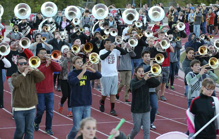The Churchill High band practices. The school was informed in April 2013 that its band was one of 12 chosen for the parade. Photo: Kin Man Hui / Kin Man Hui / San Antonio Express-News / ©2014 San Antonio Express-News