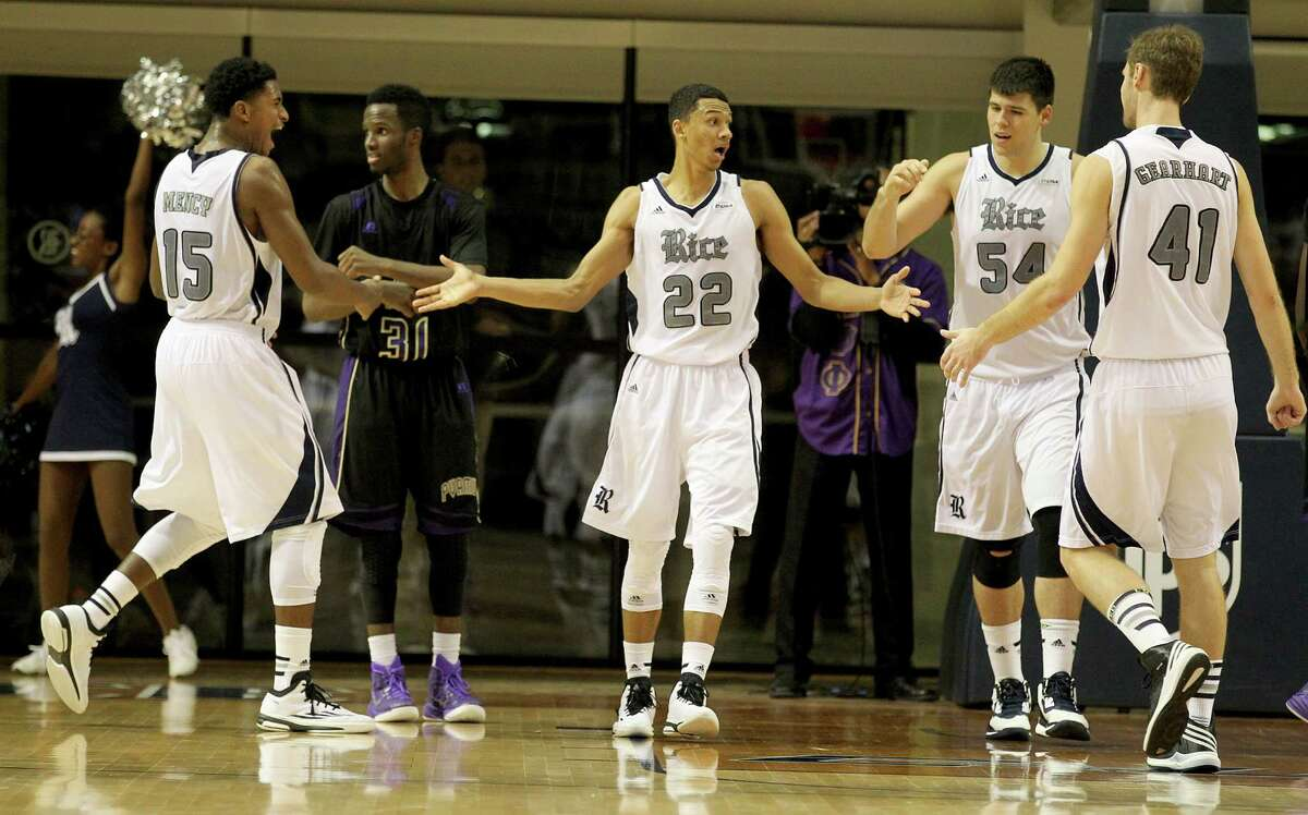 Rice Owls guard Marcus Jackson (22) is congratulated by teammates guard Bishop Mency (15) , center Andrew Drone (54) and forward Seth Gearhart (41) after scoring a basket agains the Prairie View A&M Panthers in the second half in a NCAA mens basketball game on Tuesday, November 19, 2014 at Tudor Fieldhouse in Houston, TX. Rice won 68 to 64.
