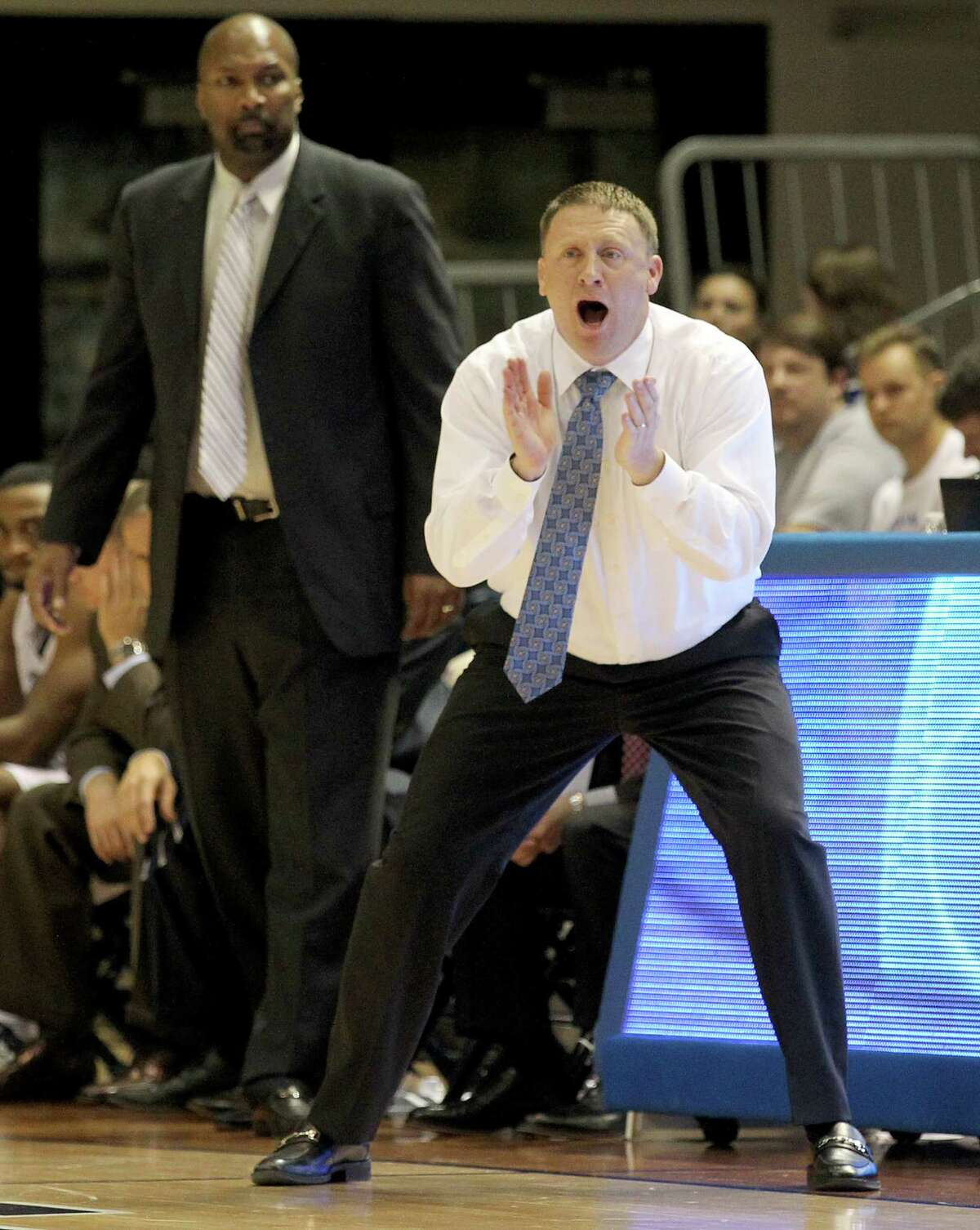 Rice Owls head coach Mike Rhoades screams while the Rice Owls play the Prairie View A&M Panthers in the second half in a NCAA mens basketball game on Tuesday, November 19, 2014 at Tudor Fieldhouse in Houston, TX. Rice won 68 to 64.