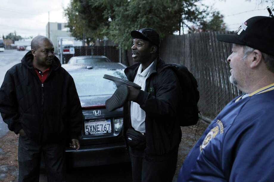 Mike Barden, center, speaks with Demaurae Houston, left, and Steve Bender, right, after he voted at Loop Transportation on whether employees should unionize. Employees of Loop Transportation voted on Wednesday, November 19, 2014, to unionize and join Teamsters Local 853 at the company's headquarters in San Carlos, Calif. The employees are the first tech bus drivers to unionize, seeking better working conditions. Photo: Carlos Avila Gonzalez / The Chronicle / ONLINE_YES