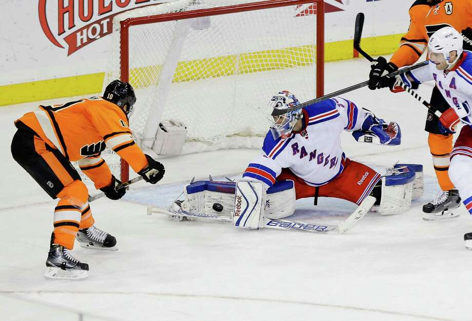 New York Rangers goalie Cam Talbot (33) stops a shot by Philadelphia Flyers' Brayden Schenn during the third period of an NHL hockey game Wednesday, Nov. 19, 2014, in New York. The Rangers won 2-0. (AP Photo/Frank Franklin II) ORG XMIT: MSG114 Photo: Frank Franklin II / AP