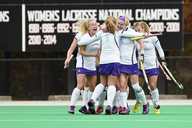 The University at Albany field hockey team celebrates an NCAA Tournament victory over Maryland that puts the Great Danes in the Final Four. (Beth Strauss / Special to the Times Union)