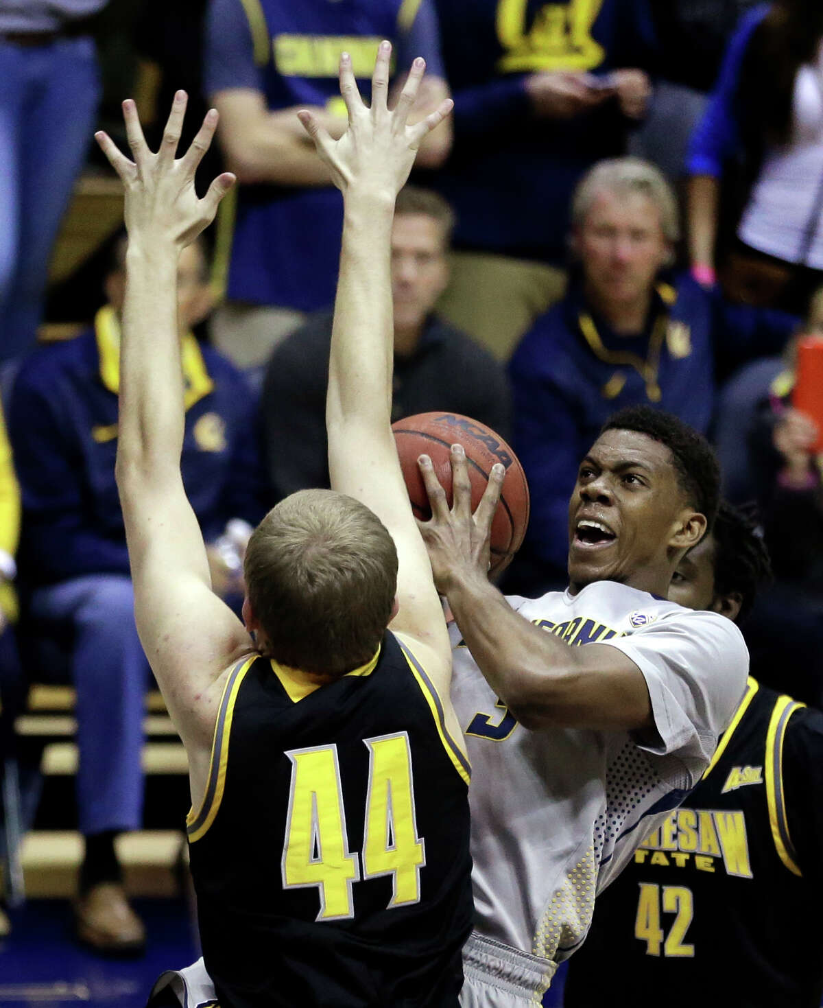 California's Tyrone Wallace, right, shoots against Kennesaw State's Justin Diecker in the second half of an NCAA college basketball game Sunday, Nov. 16, 2014, in Berkeley, Calif.