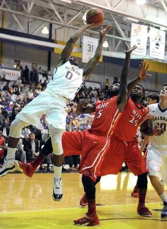 UAlbany's Evan Singletary drives to the basket during their college men's basketball game against NJIT at the SEFCU Arena on Wednesday Nov. 19, 2014 in Albany, N.Y. (Michael P. Farrell/Times Union) Photo: Michael P. Farrell / 00029534A