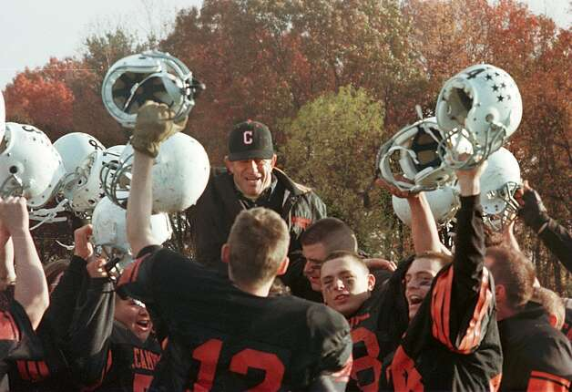 Times Union Staff Photo by  LUANNE  M.FERRIS -- CAMBRIDGE HEAD COACH KEN BAKER IS HOSTED UP ON THE SHOULDERS OF THE VICTORIOUS CAMBRIDGE INDIANS WHO DEFEATED GREENWICH IN THE CLASS C CHAMPIONSHIP GAME AT COLONIE ON SAT. NOV. 4, 1995. Photo: LUANNE M. FERRIS / ALBANY TIMES UNION