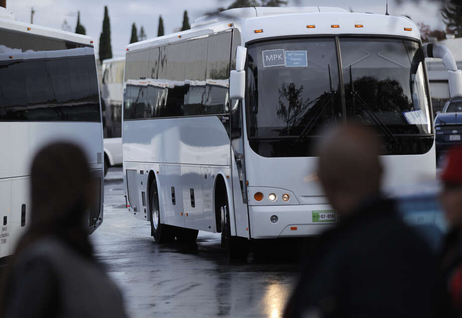 Members of Teamsters 853 and employees of Loop Transportation watch as a tech bus leaves the company yard during the drivers' vote to join the union. Photo: Carlos Avila Gonzalez / The Chronicle / ONLINE_YES