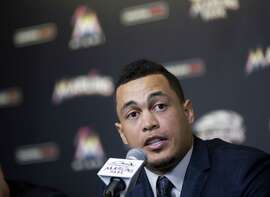 Giancarlo Stanton discusses his new record $325 million, 13-year contract with the Miami Marlins at a news conference Wednesday, Nov. 19, 2014, in Miami. The contract is the most lucrative for an American athlete and the longest in baseball history. (AP Photo/J Pat Carter)
