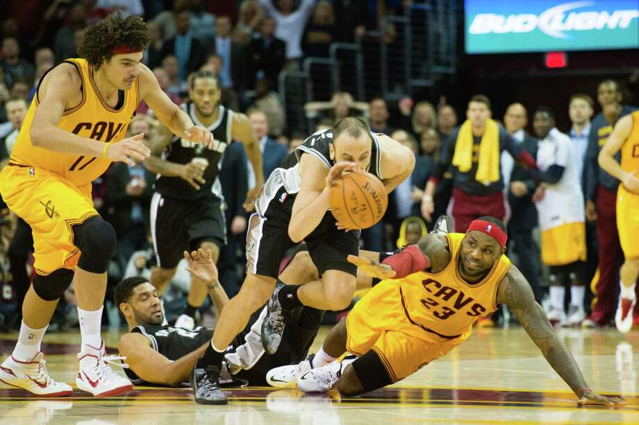 CLEVELAND, OH - NOVEMBER 19: Manu Ginobili #9 of the San Antonio Spurs steals the ball from LeBron James #23 of the Cleveland Cavaliers during finals seconds of the second half at Quicken Loans Arena on November 19, 2014 in Cleveland, Ohio. The Spurs defeated the Cavs 92-90. User expressly acknowledges and agrees that, by downloading and or using this photograph, User is consenting to the terms and conditions of the Getty Images License Agreement. Photo: Jason Miller, Getty Images / 2014 Getty Images