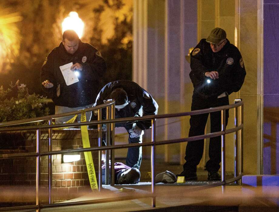 EDS NOTE: GRAPHIC CONTENT - Tallahassee police investigate the scene of a shooting outside the Strozier library on the Florida State University campus in Tallahassee, Fla. Thursday Nov 20, 2014.  Officers shot and killed the suspected gunman police said, but it has not been confirmed by authorities yet that the body in this image is that of the dead gunman. There were no other fatalities in the shooting. Photo: Mark Wallheiser, AP / FR171224 AP