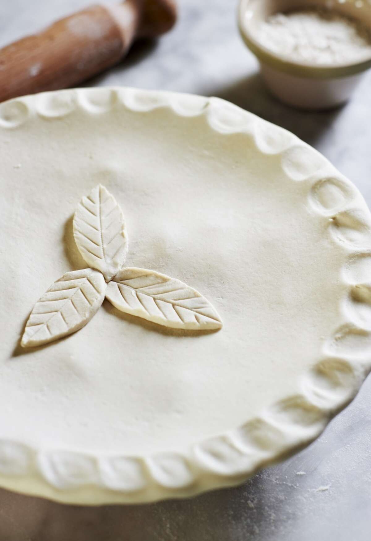 C Crusts on pecan and pumpkin pies can get soggy unless they're partially baked before filling. Blind-bake the crust by lining the unbaked crust with foil, then filling it with pie weights or dry beans and baking until the crust is about three-fourths done.