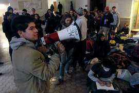 Students occupy Wheeler Hall at UC Berkeley on Thursday, Nov. 20, 2014 to oppose a 5% tuition increase approved by a University of California Board of Regents committee Wednesday. The full board is expected to pass the increase Thursday.