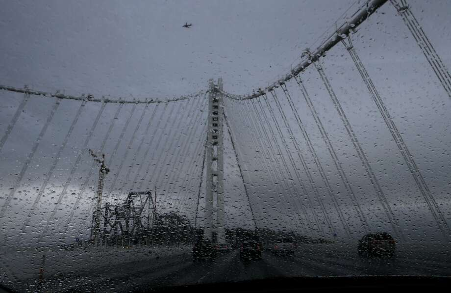The first of three rain storms moved across the Bay bridge during the morning commute as seen on Wednesday Nov. 19, 2014, in San Francisco, Calif. Photo: Michael Macor, The Chronicle