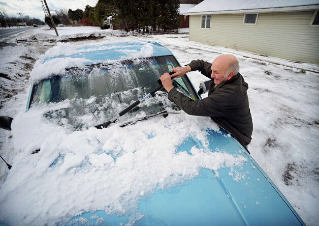 Floyd Compeau, 65, removes snow from his 1994 Chevy pickup truck on Wednesday, Nov. 19, 2014 outside in house in Brushton, N.Y. (AP Photo/The Watertown Daily Times, Jason Hunter)  SYRACUSE OUT ORG XMIT: NYWAT202 Photo: Jason Hunter, AP / Watertown Daily Times