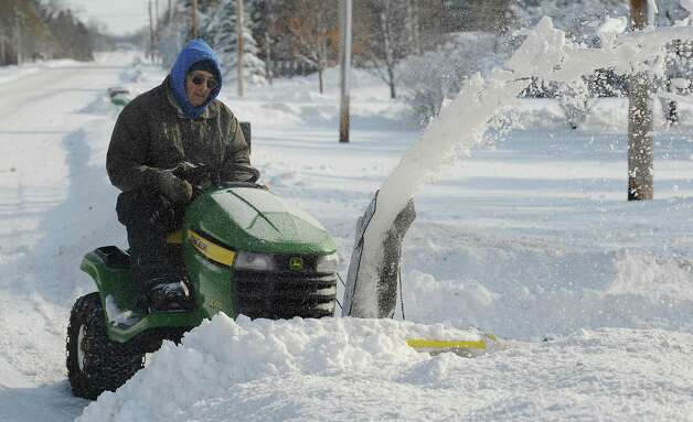 Bill Funke clears snow out his driveway at his home along Route 5 in Pembroke, N.Y., Wednesday morning, Nov. 19, 2014. (AP Photo/The Daily News, Mark Gutman) ORG XMIT: NYBAT201 Photo: Mark Gutman, AP / The Daily News