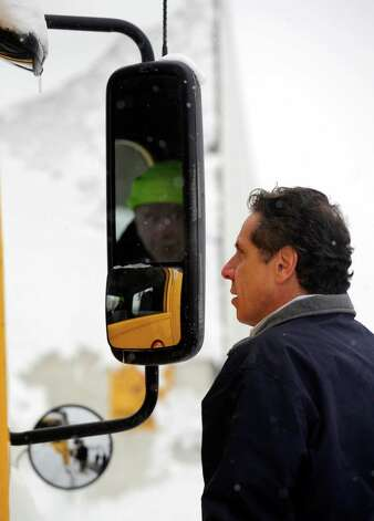 New York Gov. Andrew M. Cuomo listens to a truck driver stranded on the New York State Thruway in West Seneca, N.Y. Wednesday, Nov. 19, 2014. The governor was in town to see the snowstorm first hand. Cuomo says the Buffalo area is in the middle of a three-phase storm event that may end with flooding over the weekend. (AP Photo/Gary Wiepert) ORG XMIT: NYGW114 Photo: Gary Wiepert, AP / FR170498 AP