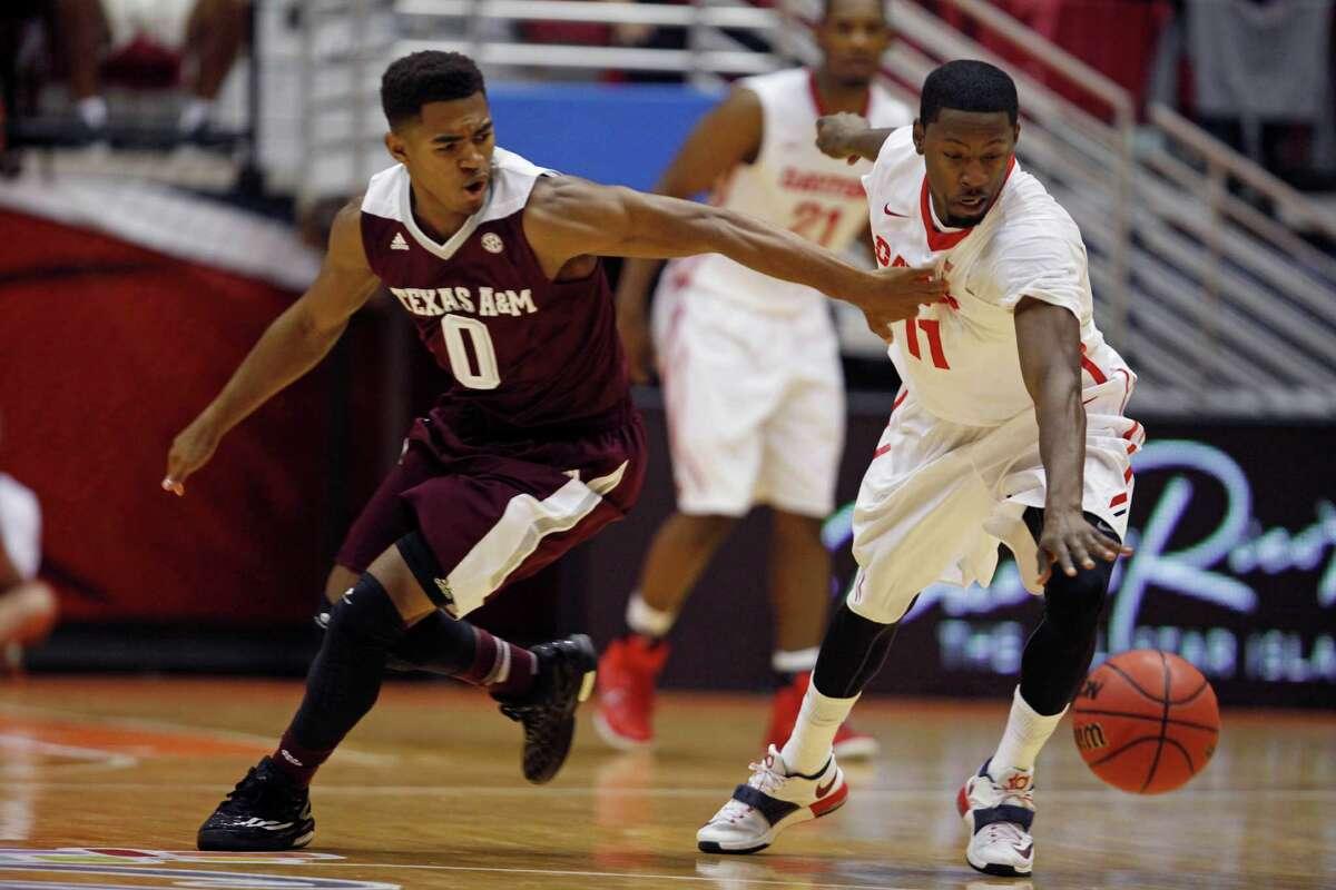 Dayton's Scoochie Smith, right, steals the ball from Texas A&M Avery Johnson during a NCAA college basketball game in San Juan, Puerto Rico, Thursday, Nov. 20, 2014. (AP Photo/Ricardo Arduengo)
