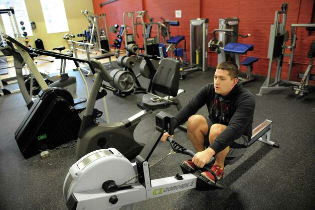 Resident Corbin Joshu, 26, works out in the fitness center on Wednesday, Nov. 12, 2014, at the Lofts at Harmony Mills in Cohoes, N.Y. (Cindy Schultz / Times Union) Photo: Cindy Schultz / 00029442A