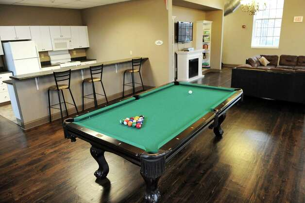 The lounge includes a kitchenette and pool table and is available for residents' private gatherings on Wednesday, Nov. 12, 2014, at the Lofts at Harmony Mills in Cohoes, N.Y. (Cindy Schultz / Times Union) Photo: Cindy Schultz / 00029442A
