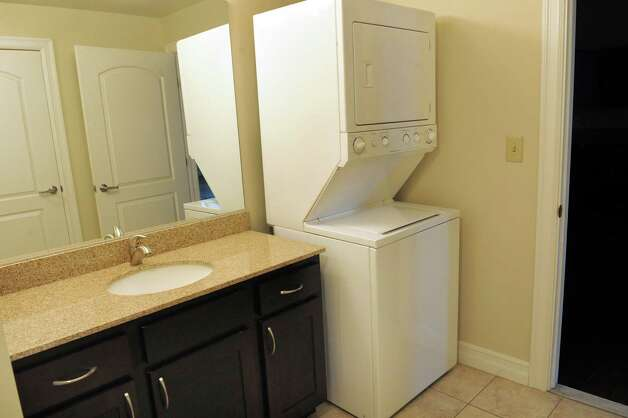 A compact washer and dryer unit are included in each apartment on Wednesday, Nov. 12, 2014, at the Lofts at Harmony Mills in Cohoes, N.Y. (Cindy Schultz / Times Union) Photo: Cindy Schultz / 00029442A