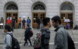 Students outside Wheeler Hall on the UC Berkeley campus.