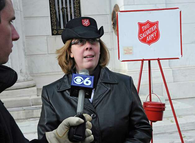 Capt. Amber Boone, corps commanding officer of the Saratoga Salvation Army, speaks to the media on the season's opening day for the bell ringing for Salvation Army on Thursday, Nov. 20, 2014 in Saratoga Springs, N.Y.  (Lori Van Buren / Times Union) Photo: Lori Van Buren