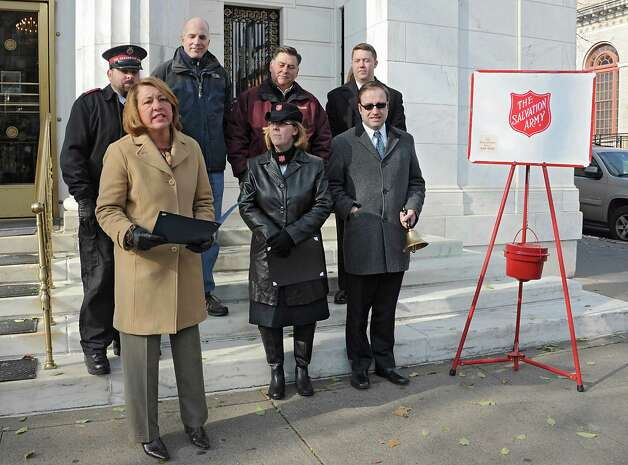 Saratoga Springs Mayor Joanne Yepsen reads the proclamation for the season's opening day for Saratoga Springs' bell ringing for Salvation Army on Thursday, Nov. 20, 2014 in Saratoga Springs, N.Y.  (Lori Van Buren / Times Union) Photo: Lori Van Buren