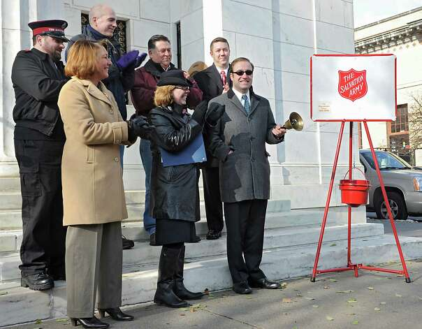 Charles Wait Jr., executive vice president for Adirondack Trust, right, rings the bell to kick off Saratoga Springs' opening day for bell ringing for Salvation Army on Thursday, Nov. 20, 2014 in Saratoga Springs, N.Y.  (Lori Van Buren / Times Union) Photo: Lori Van Buren