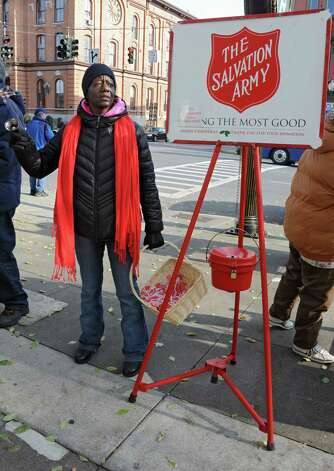 Kathy Sephas of Saratoga Springs rings the Salvation Army bell along Broadway on Thursday, Nov. 20, 2014 in Saratoga Springs, N.Y. Today was Saratoga Spring's opening day for annual tradition. (Lori Van Buren / Times Union) Photo: Lori Van Buren