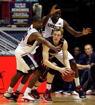 UCONN guard Rodney Purvis, left, and teammate forward Kentan Facey, pressur Charleston guard Canyon Barry during an NCAA college basketball game against Charleston in San Juan, Puerto Rico, Thursday, Nov. 20, 2014. (AP Photo/Ricardo Arduengo Photo: Ricardo Arduengo, AP / Associated Press