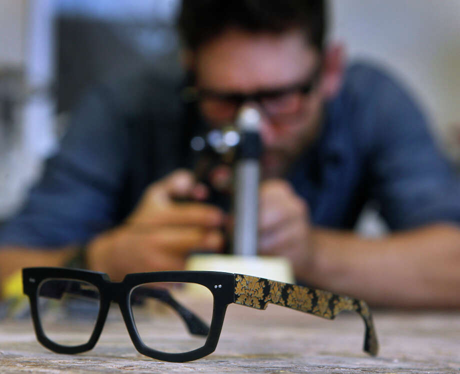 Sam Hilliard works on a pair of custom eyeglasses at TechShop San Francisco. Hilliard offers bespoke eyewear, designed from bull horn, at his space at the Artful Gentleman showroom in S.F. Photo: Paul Chinn / The Chronicle / ONLINE_YES
