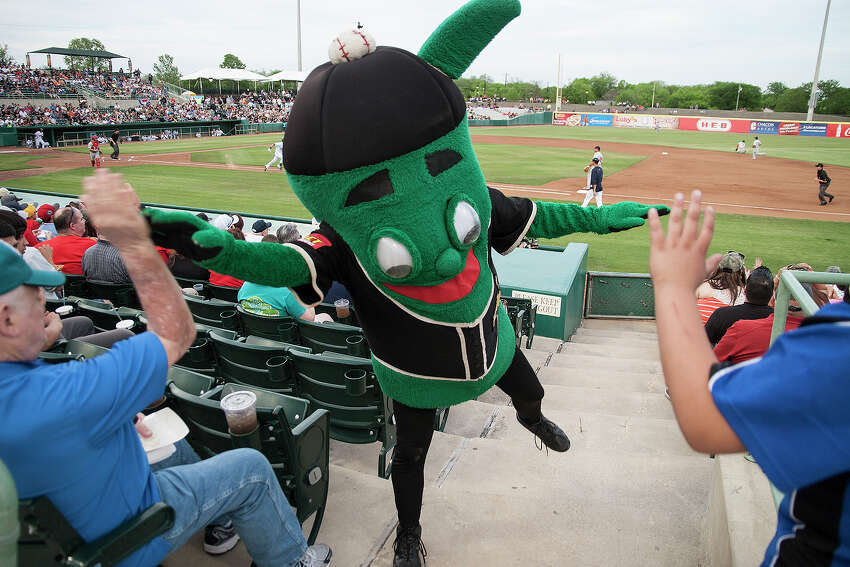 Joe Tinti gets a high-five from Ballapeno, one of the Missions mascots at the home opener against the Springfield Cardinals, Thursday, April 10, 2014 at Wolff stadium.