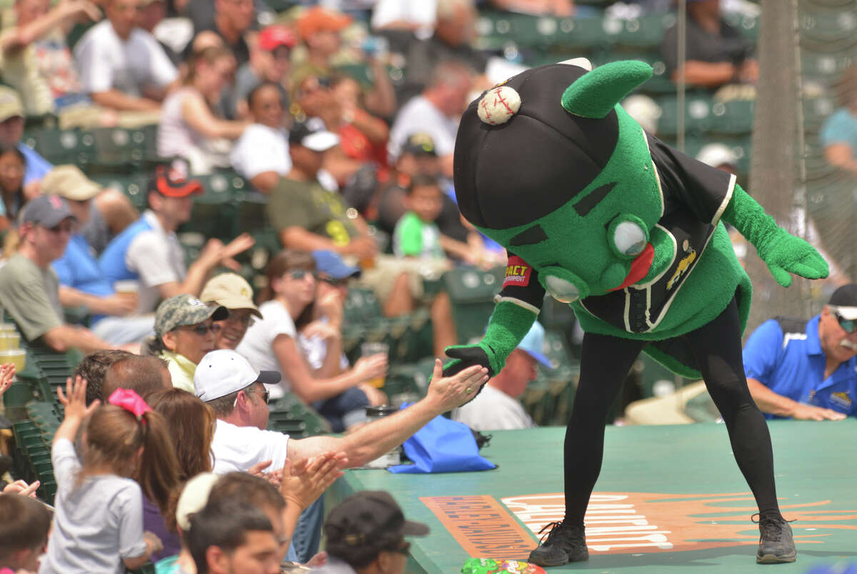 """Missions mascot """"Ballapeno"""" high-fives fns during the Missions game versus Tulsa Sunday."""