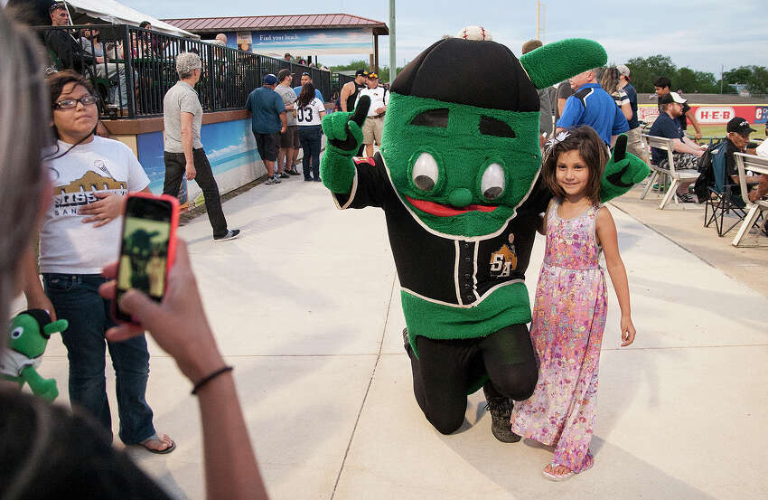 Laryssa McNaught, 6, takes a photo with the Mission's mascot Ballapeno at the San Antonio Mission's home opener Thursday, April 10, 2014 at Wolff stadium against the Springfield Cardinals.