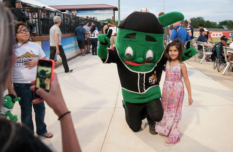 Laryssa McNaught, 6, takes a photo with the Mission's mascot Ballapeno at the San Antonio Mission's home opener Thursday, April 10, 2014 at Wolff stadium against the Springfield Cardinals. Photo: Alma E. Hernandez, San Antonio Express-News