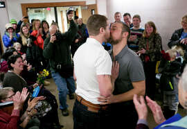 Ben Bahnsen (left) and Patrick Donnelly kiss after marrying in Bozeman, Mont.