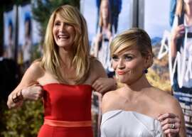 """Actresses Laura Dern and Reese Witherspoon arrive at the Premiere of Fox Searchlight's """"Wild"""" at AMPAS Samuel Goldwyn Theater on November 19, 2014 in Beverly Hills, California."""