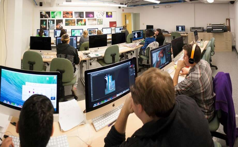 Students at the College of Saint Rose use the new, advanced digital color photography studio and fabrication lab. (Benjamin Marvin)