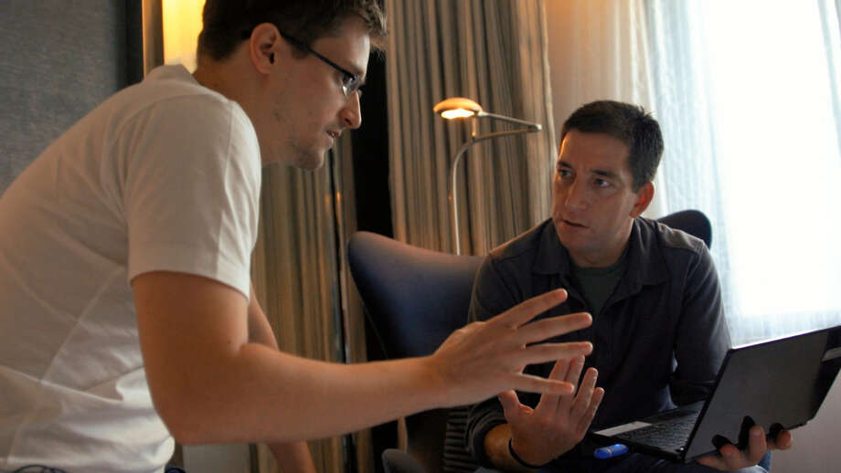 "In this image released by Radius TWC, Edward Snowden, left, appears with Glenn Greenwald in a scene from ""Citizenfour,"" a documentary that intimately captures  Snowden during his leak of NSA documents. (AP Photo/Radius TWC) ORG XMIT: NYET313 / Radius TWC"