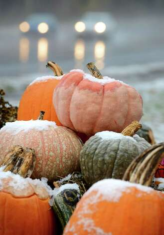 Snow capped pumpkins get a drizzling of rain outside Burger's Market Garden Monday afternoon, Nov. 17, 2014, on Route 7 Niskayuna, N.Y. (Will Waldron/Times Union) Photo: WW / 00029520A