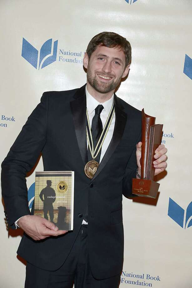 Phil Klay, winner of the National Book Award for fiction, attends the 65th Annual National Book Awards on Nov. 19, 2014 at Cipriani Wall Street in New York City Wednesday Nov. 19, 2014. (AP Photo/National Book Foundation, Robin Platzer) ORG XMIT: NY107 Photo: Robin Platzer/Twin Images / Robin Platzer/Twin Images
