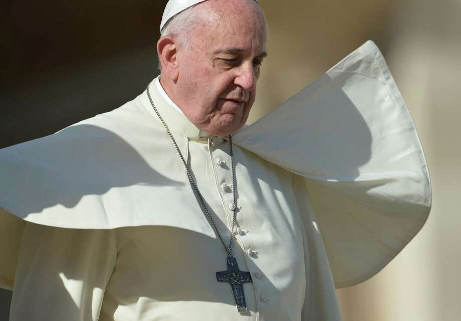 The pellegrina of Pope Francis is lifted by a gust of wind during his general audience at St Peter's square on Thursday. Francis is pushing for pastoral change but not doctrinal changes. Photo: VINCENZO PINTO / Vincenzo Pinto / AFP / Getty Images / AFP