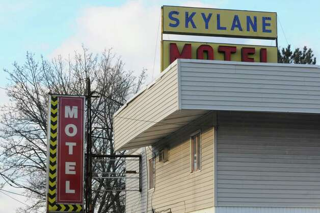 Colonie Police begin the process of eviction at the Skylane Motel on Thursday, Jan. 23, 2014, in Colonie, N.Y. (Michael P. Farrell/Times Union archive) Photo: Michael P. Farrell / 00025467A