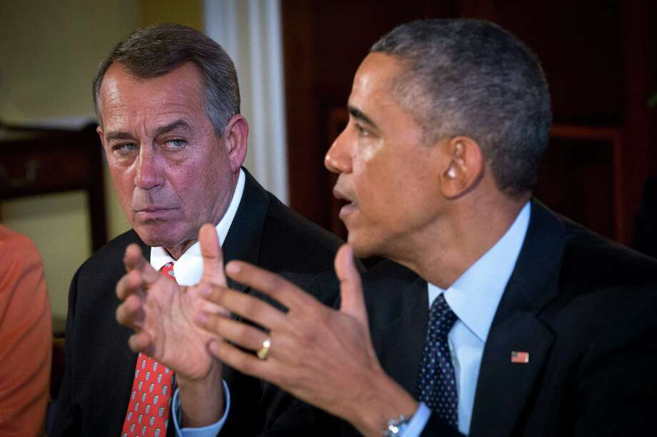 House Speaker John Boehner (R-Ohio) listens as President Barack Obama speaks at a lunch meeting with congressional leaders from both parties at the White House. Readers continue to discuss the impact of the recent elections. Photo: DOUG MILLS / DOUG MILLS / New York Times / NYTNS
