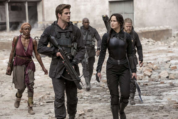 The Hunger Games: Mockingjay (2014) American science fiction adventure film directed by Francis Lawrence with a screenplay by Peter Craig and Danny Strong. It is the first of two cinematic parts based on the novel Mockingjay, the final book in The Hunger Games trilogy, written by Suzanne Collins, and the third installment in The Hunger Games film series, produced by Nina Jacobson and Jon Kilik and distributed by Lionsgate. The film stars Jennifer Lawrence, Josh Hutcherson, Liam Hemsworth, Woody Harrelson, Elizabeth Banks, Julianne Moore, Philip Seymour Hoffman, Jeffrey Wright, Stanley Tucci and Donald Sutherland. It is the sequel to The Hunger Games: Catching Fire and will be followed by the concluding entry, The Hunger Games: Mockingjay   Part 2.