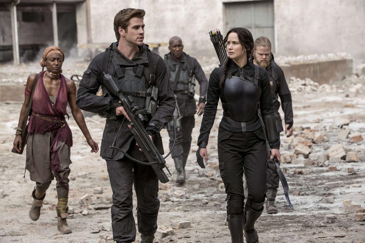 """The Hunger Games: Mockingjay - Part I"" stars Liam Hemsworth and Jennifer Lawrence as rebel leaders."